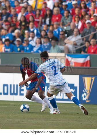 CARSON, CA. - JULY 3: Concacaf Gold Cup soccer match, Costa Rica vs. El Salvador at the Home Depot center in Carson. Froylan Ledezma trying to get past Alexander Escobar on July 3, 2009.