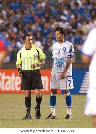 CARSON, CA. - JULY 3: Concacaf Gold Cup soccer match, Costa Rica vs. El Salvador at the Home Depot Center in Carson. Ramon Sanchez with the referee talking to him. July 3, 2009.