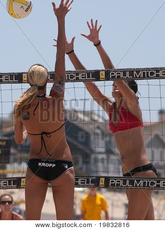 MANHATTAN BEACH, CA. - JULY 18: Jenny Kropp spikes and Mariko Coverdale attempting to block at the AVP Manhattan Beach Open on July 18th 2009.