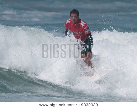 HUNTINGTON BEACH, CA. - JULY 26: Adriano de Souza competing at the Hurley US Open of Surfing in Huntington Beach, CA. on July 26th 2009.