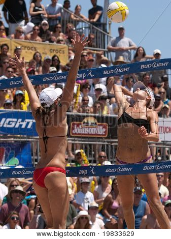 HERMOSA BEACH, CA. - AUGUST 8: Jen Kessy (R) and April Ross vs. Nicole Branagh and Elaine Youngs (L) for the womens final of the AVP Hermosa Beach Open. August 8, 2009 in Hermosa Beach.