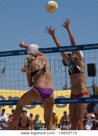 HERMOSA BEACH, CA. - AUGUST 8: Jen Kessy (L) and April Ross vs. Nicole Branagh and Elaine Youngs (R) for the womens final of the AVP Hermosa Beach Open. August 8, 2009 in Hermosa Beach.