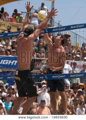 HERMOSA BEACH, CA. - AUGUST 9: Phil Dalhausser and Todd Rogers (R) vs. John Hyden and Sean Scott (L) for the mens final of the AVP Hermosa Beach Open. August 9, 2009 in Hermosa Beach.