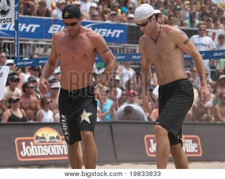 HERMOSA BEACH, CA. - AUGUST 9: Phil Dalhausser and Todd Rogers vs. John Hyden (R) and Sean Scott (L) for the mens final of the AVP Hermosa Beach Open. August 9, 2009 in Hermosa Beach.