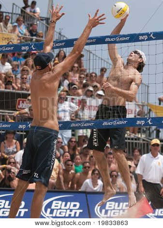 HERMOSA BEACH, CA. - AUGUST 9: Phil Dalhausser (L) and Todd Rogers vs. John Hyden (R) and Sean Scott for the mens final of the AVP Hermosa Beach Open. August 9, 2009 in Hermosa Beach.