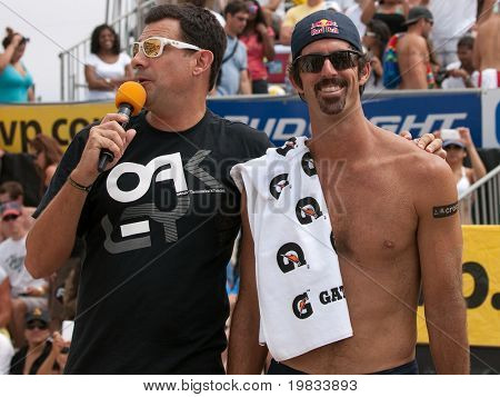 HERMOSA BEACH, CA. - AUGUST 9: Todd Rogers being interviewed by Chris