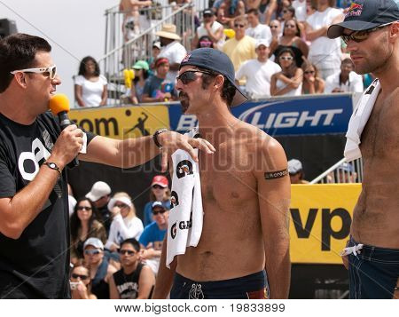 HERMOSA BEACH, CA. - AUGUST 9: Phil Dalhausser (R) and Todd Rogers (L) being interviewed after winning the mens final of the AVP Hermosa Beach Open. August 9, 2009 in Hermosa Beach.