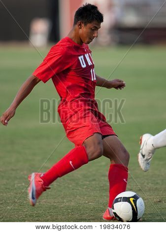 NORTHRIDGE, CA. - AUGUST 28: Robert Garcia taking a shot on goal during the UNLV vs. CSUN pre-season exhibition on August 28, 2009 in Northridge, Ca.