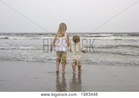 Two Young Kids At The Beach