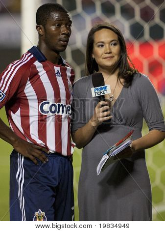 CARSON, CA. - OCTOBER 17: Michael Lahoud (L) gives an interview to Amanda Fletcher (R) at halftime of the Chivas USA vs. San Jose Earthquakes match at the Home Depot Center on October 17, 2009