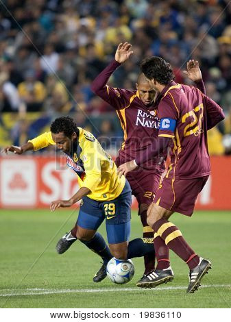 CARSON, CA. - JANUARY 9: Jean Beausejour (L) foulded by Diego Jimenez (C) & Juan Carlso (R) during the match of Club America & Estudiantes Tecos at the Home Depot Center January 9, 2010 in Carson, CA.