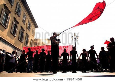 protester with red flag