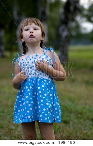 Displeased Grimasing Little Girl