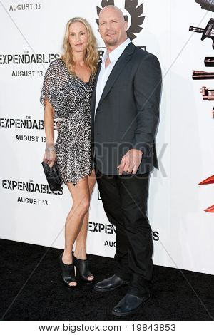 "HOLLYWOOD, CA. - AUG 3: ""Stone Cold"" Steve Austin (R) and guest arrives at The Expendables Los Angeles premiere at Grauman's Chinese Theater on August 3, 2010 in Hollywood, Ca."