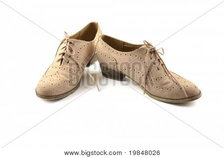 Vintage woman shoes on a white background