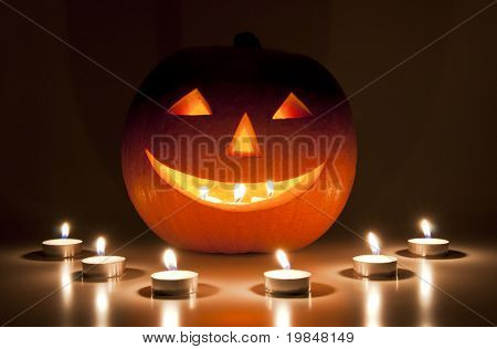 Halloween pumpkin lantern lit by candles
