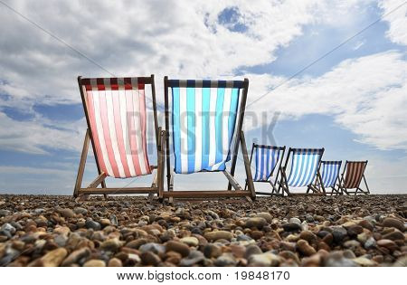 Deck chairs on Brighton beach, UK
