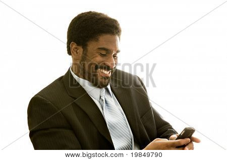 Handsome African-American business reading text message on cell phone