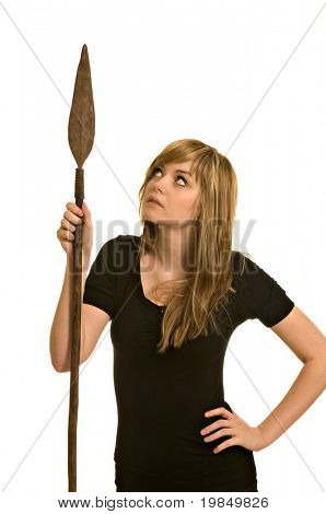 A pretty young woman holds an African tribal spear (isolated against white background)