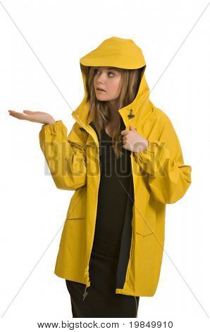 A pretty young woman, isolated against a white background, wears a yellow raincoat, waiting for it to rain.