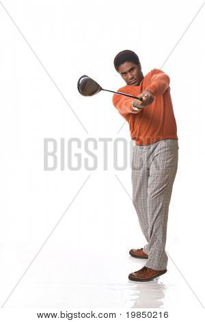 Handsome African-American man swings a golf club