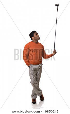 Handsome African-American man holds a golf club