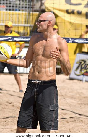GLENDALE, AZ - SEPTEMBER 27: Olympic gold medalist Phil Dalhausser prepares to serve at the AVP Best of the Beach volleyball tournament in Glendale, Arizona.
