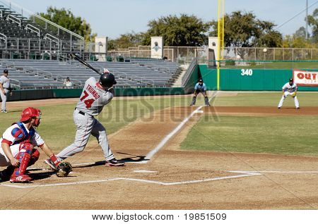MESA, AZ - NOV 20: Mark Trumbo of  the Scottsdale Scorpions hits with Mesa Solar Sox catcher Lou Marson behind the plate, in the Arizona Fall League game on November 20, 2008 in Mesa, Arizona