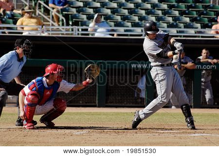 MESA, AZ - NOV 20: Chris Johnson of  the Scottsdale Scorpions swings with Mesa Solar Sox catcher Lou Marson behind the plate, in the Arizona Fall League game on November 20, 2008 in Mesa, Arizona.
