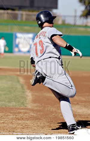 MESA, AZ - NOV 20: Brian Bogusevic of the Scottsdale Scorpions rounds first base in the Arizona Fall League game with the Mesa Solar Sox on November 20, 2008 in Mesa, Arizona.
