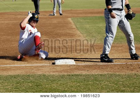 MESA, AZ - NOV 20: Lou Marson of the Mesa Solar Sox slides into third base in the Arizona Fall League baseball game with the Scottsdale Scorpions on November 20, 2008 in Mesa, Arizona.
