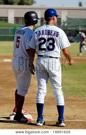 MESA, AZ - NOV 20: Baseball Hall of Famer Ryne Sandberg of the Mesa Solar Sox coaches Lou Marson in the Arizona Fall League game with the Scottsdale Scorpions on November 20, 2008 in Mesa, Arizona.