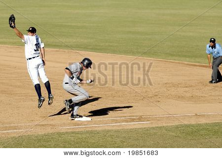 MESA, AZ - NOV 20: First base Casper Wells of the Mesa Solar Sox stretches as Brian Bogusevic of the Scottsdale Scorpions reaches first in an Arizona Fall League game on November 20, 2008 in Mesa, AZ