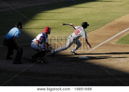 MESA, AZ - NOV 20: Chris Pettit of the Scottsdale Scorpions hits with catcher Lou Marson of the Mesa Solar Sox behind the plate in the Arizona Fall League game on November 20, 2008 in Mesa, Arizona.