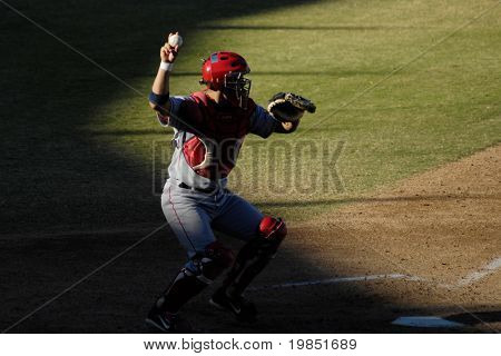 MESA, AZ - NOV 20: Catcher Mark Wagner of the Scottsdale Scorpions throws the ball in the Arizona Fall League baseball game with the Mesa Solar Sox on November 20, 2008 in Mesa, Arizona.