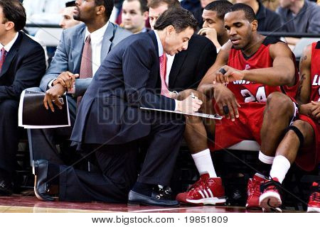 GLENDALE, AZ - DECEMBER 20: Coach Rick Pitino of the Louisville Cardinals outlines a play for Samardo Samuels #24 in the basketball game against Minnesota on December 20, 2008 in Glendale, Arizona.