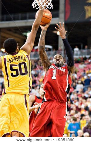 GLENDALE, AZ - DECEMBER 20: Louisville's Terrence Williams #1 shoots the ball over defender Ralph Sampson #50 of Minnesota in the basketball game on December 20, 2008 in Glendale, Arizona.