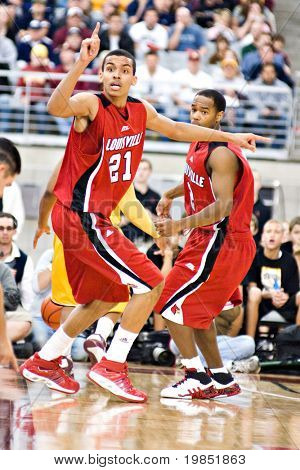 GLENDALE, AZ - DECEMBER 20: Louisville's Jared Swopshire #21 gestures as teammate Preston Knowles #2 watches in the basketball game against Minnesota on December 20, 2008 in Glendale, Arizona.