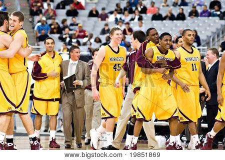 GLENDALE, AZ - DECEMBER 20: The Minnesota Gophers basketball team celebrates their upset victory over the Louisville Cardinals on December 20, 2008 in Glendale, Arizona.