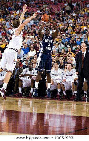 GLENDALE, AZ - DECEMBER 20: Brigham Young University guard Archie Rose #5 puts up a jump shot during the basketball game against Arizona State University on December 20, 2008 in Glendale, Arizona.
