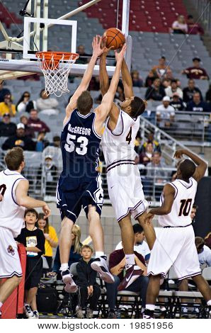 GLENDALE, AZ - DECEMBER 20: Jeff Pendergraph #4 of Arizona State University and Gavin MacGregor #53 reach for a rebound during the basketball game on December 20, 2008 in Glendale, Arizona.
