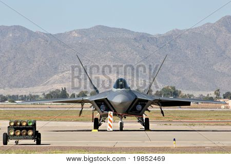 GLENDALE, AZ - MARCH 21: A U.S. Air Force F-22 Raptor fighter parked on the runway at the biennial air show (