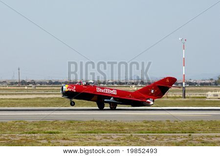 "GLENDALE, AZ - MARCH 21: Bill Reesman lands a Russian MiG-17 at the biennial air show (""Thunder in the Desert"") at Luke Air Force Base on March 21, 2009 in Glendale, AZ."