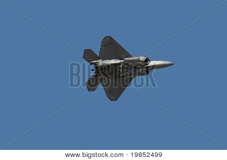 GLENDALE, AZ - MARCH 21: A U.S. Air Force F-22 Raptor makes a pass with its bomb bay open at the biennial air show (
