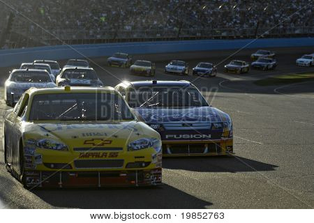 AVONDALE, AZ - APRIL 18: Clint Bowyer #33 leads a group of cars at the NASCAR Sprint Cup race at the Phoenix International Raceway on April 18, 2009 in Avondale, AZ.