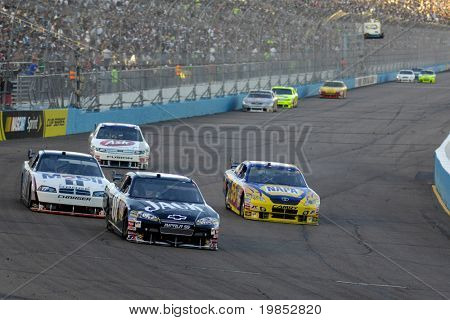 AVONDALE, AZ - APRIL 18: Casey Mears #07 leads a group of cars in the NASCAR Sprint Cup race at the Phoenix International Raceway on April 18, 2009 in Avondale, AZ.