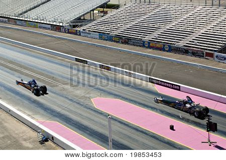 CHANDLER, AZ - OCTOBER 2: Dragsters compete in the NHRA Pacific Division drag racing championship on October 2, 2009 in Chandler, Arizona.