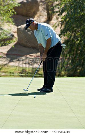 SCOTTSDALE, AZ - OCTOBER 21: Tom Lehman putts in the Frys.com Open PGA golf tournament on October 21, 2009 in Scottsdale, Arizona.