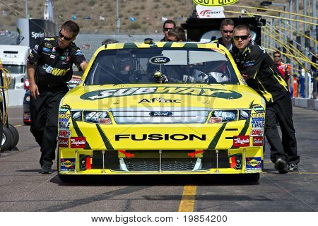 AVONDALE, AZ - APRIL 10: The pit crew pushes the #99 Subway Ford car, driven by Carl Edwards, onto the track before the start of the Subway Fresh Fit 600 on April 10, 2010 in Avondale, AZ.