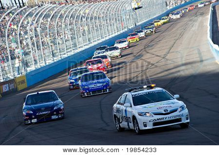 AVONDALE, AZ - APRIL 10: The pace car leads a line of cars during a yellow caution flag at the Subway Fresh Fit 600 NASCAR Sprint Cup race on April 10, 2010 in Avondale, AZ.